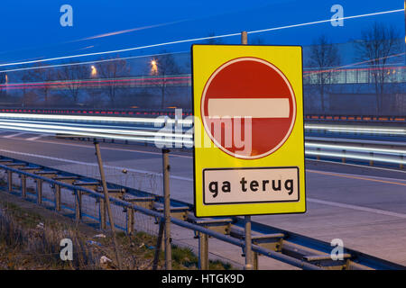 Gildehaus, Germany. 10th Mar, 2017. A sign reads 'ga terug' (lit. going back) seen at the German-Dutch border crossing - Stock Photo