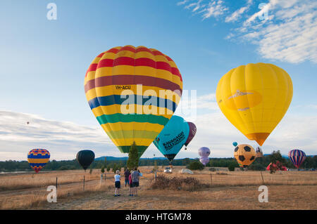 Canberra, Australia. 12th Mar, 2017. Hot air balloons land next to the Lake Burley Griffin during 'Balloon Spectacular' - Stock Photo