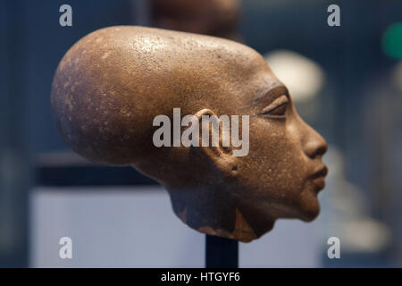 Egyptian princess. Quartzite head of a statue of one of the six daughters of Pharaoh Akhenaten and Queen Nefertiti - Stock Photo