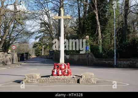 War Memorial, Sawston, Cambridgeshire, remembers those who died in two world wars and the Korean War. - Stock Photo