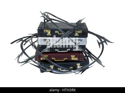 Sharp razor wired used as a barrier around a stack of briefcases - path included - Stock Photo