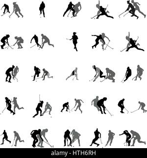 Players in hockey on the grass silhouette set - Stock Photo