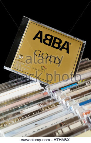 GOLD, ABBA CD pulled out from among rows of other CD's, England - Stock Photo