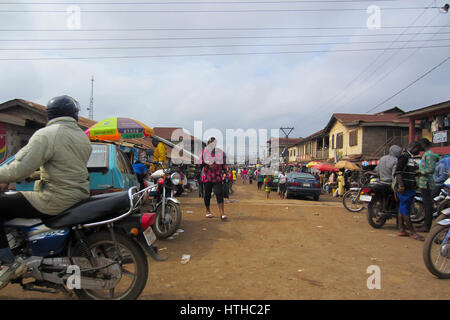 People trading in the street in the city of Lagos, the largest city in Nigeria and the African continent. Lagos - Stock Photo