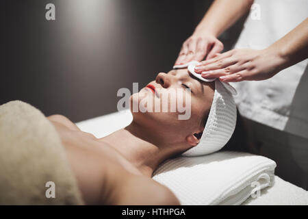 Woman enjoying skin and face treatment and massage - Stock Photo