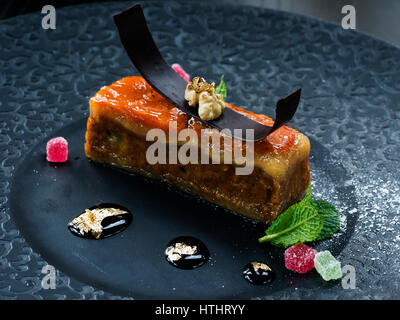 Marzipan dessert. Marzipan is a confection consisting primarily of sugar or honey and almond meal (ground almonds), - Stock Photo