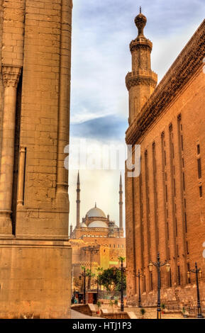 View of the Muhammad Ali Mosque between the Mosques of Sultan Hassan and Al Rifai - Cairo, Egypt - Stock Photo
