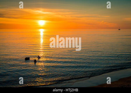 Sunset over the ocean viewed from Brighton Beach, South Australia - Stock Photo