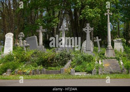 HIGHGATE, LONDON, UK - March 12, 2016: Graves in the East cemetery of Highgate Cemetery - Stock Photo