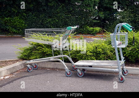 BASINGSTOKE, UK - JULY 20, 2016: Trolleys in the car park of the HomeBase DIY home improvement store - Stock Photo