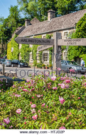 Wooden signboard in the scenic village Bibury in the Cotswold District, Gloustershire, England, UK - Stock Photo