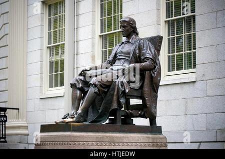 Harvard University - Statue of John Harvard in Harvard Yard, Cambridge, Massachusetts - Stock Photo
