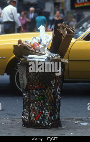 Overflowing Garbage Container,New York City - Stock Photo