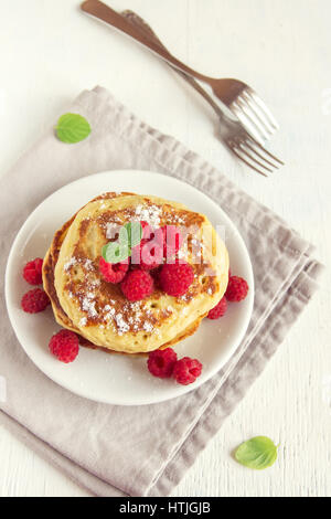 Stack of fresh pancakes with berries (raspberries) on white plate, copy space - healthy homemade vegan vegetarian - Stock Photo