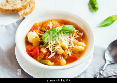 Homemade Italian Minestrone Soup with Cheese and Basil - healthy homemade hot vegetarian diet vegan meal food soup - Stock Photo