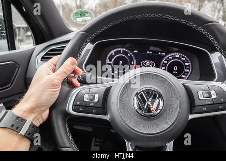 Hamburg, Germany - February 10, 2017: Volkswagen Tiguan, 4x4 R-Line. Black compact luxury crossover vehicle interior. - Stock Photo