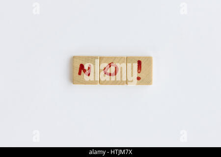 the word No  formed with letters written on squares of wood dowels - Stock Photo