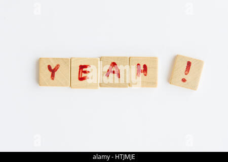the word Yeah  formed with letters written on squares of wood dowels - Stock Photo