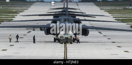 U.S. Air Force B-1B Lancer strategic bomber jet aircraft line up for take off on the runway at the Anderson Air - Stock Photo
