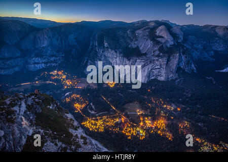 Panoramic aerial bird's eye view of famous Yosemite Valley illuminated in beautiful post sunset twilight during - Stock Photo