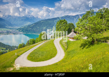Winding mountain road in beautiful mountain scenery in the Alps in summer, Zell am See, Salzburg Land, Austria - Stock Photo