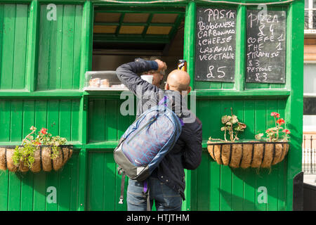 The green Cabman's Shelter in Russell Square, London, England, UK - Stock Photo