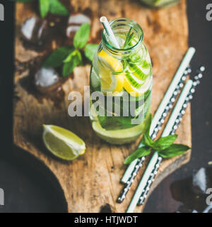 Clean eating healthy citrus sassi water in glass bottle - Stock Photo
