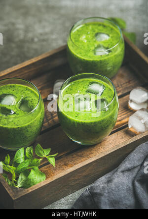 Fresh smoothie with ice cubes, mint and lime in glasses - Stock Photo