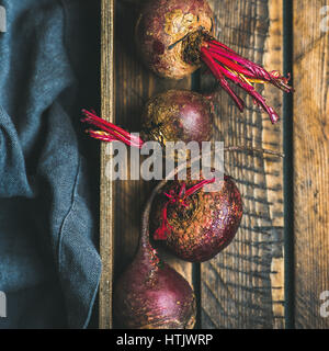Raw organic purple beetroots in wooden box, square crop - Stock Photo
