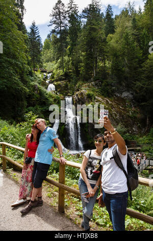 Tourists taking photographs at the Triberg Waterfalls, Black Forest, Germany - Stock Photo