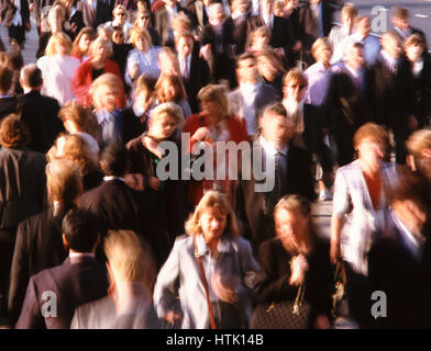 Commuters on London Bridge rushing to work in the City, London, England, UK. - Stock Photo