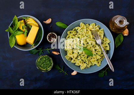 Vegan  Farfalle pasta in a basil-spinach sauce with garlic. Flat lay. Top view - Stock Photo
