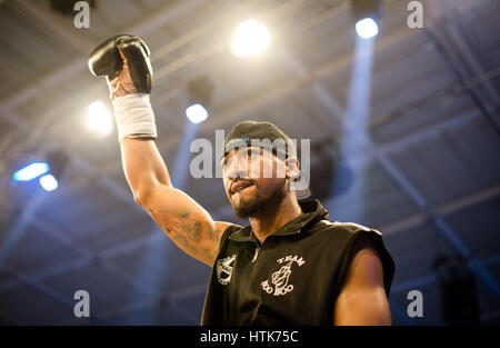 Ludwigshafen, Germany. 11th Mar, 2017. Demetrius Andrade (US) enters the ring for the WBA world half middleweight - Stock Photo