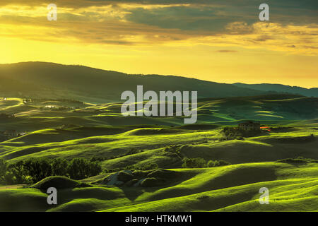 Tuscany spring, rolling hills on sunset. Rural landscape. Green fields and farmlands. Volterra Italy, Europe - Stock Photo