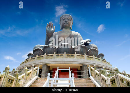 HONG KONG, CHINA - MARCH  7, 2014: The enormous Tian Tan Buddha at Po Lin Monastery at Lantau island - Stock Photo