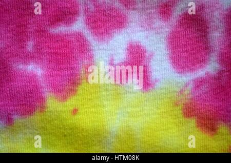 Tie dye patterns and swirls in pink and yellow - Stock Photo