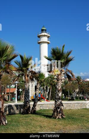 View of the lighthouse and palm trees along the promenade, Torre del Mar, Malaga Province, Andalusia, Spain, Western - Stock Photo