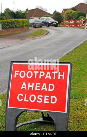 Footpath Ahead Closed sign for road works by minor road in Hellesdon, Norfolk, England, United Kingdom. - Stock Photo