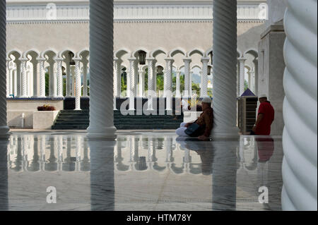 Visitors at the Sultan Omar Ali Saifuddien Mosque. The Mosque is located in Bandar Seri Begawan in the Sultanate - Stock Photo