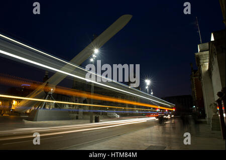 Light trails from buses passing under the Wind Turbine Blade on display as part of the UK City of Culture 2017 in - Stock Photo