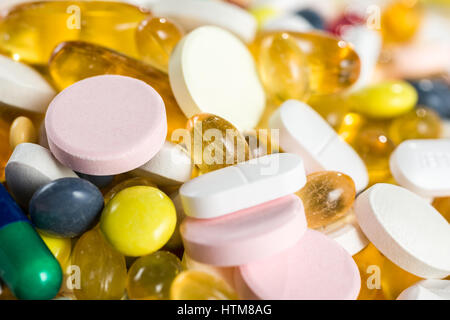 close-up medicinal drugs, pills and capsules in capsules and tablets on white background - Stock Photo