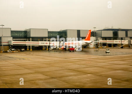 London Gatwick. England UK. EasyJet planes on London Gatwick airport runway preparing for take off. - Stock Photo