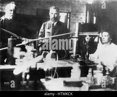Marie Curie (1867-1935) Polish-born French physicist who, with her husband Pierre (1859-1906), centre, carried out - Stock Photo