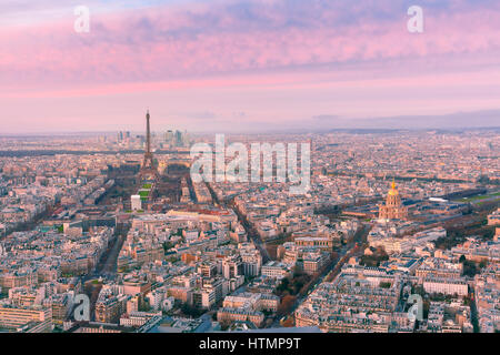 Aerial panoramic view of Paris skyline with Eiffel Tower, Les Invalides and business district of Defense at pink - Stock Photo