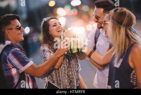 Happy friends drinking alcohol outdoors and partying before festival - Stock Photo