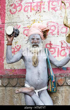 Sadhu at the Ghats on the Ganges, Varanasi, Uttar Pradesh, India - Stock Photo