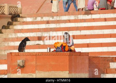 Sadhu on the Main Ghat at the Ganges, Varanasi, Uttar Pradesh, India - Stock Photo