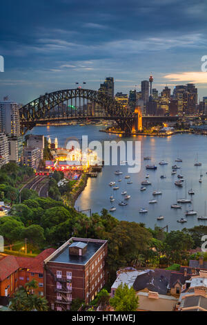 Sydney. Cityscape image of Sydney, Australia with Harbour Bridge and Sydney skyline during twilight blue hour. - Stock Photo