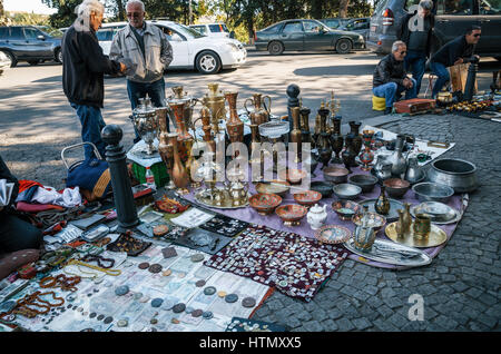 Tbilisi, Georgia - October 15, 2016: Traders and sellers of flea market on Dry bridge having a lot of vintage pitchers, - Stock Photo