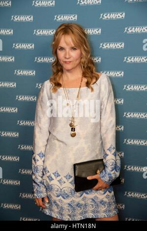Actress Lea Thompson walks the red carpet during the 2013 Substance Abuse and Mental Health Services Administration - Stock Photo